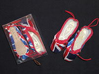 Miniature pointe shoes by Freed of London.