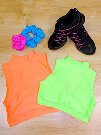 Plain lycra crop tops, dance trainers and bright coloured hair scrunchies.