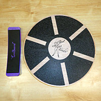 Dance training essentials like the TurnBoard and Tendu Balance board, also known as a wobbleboard.